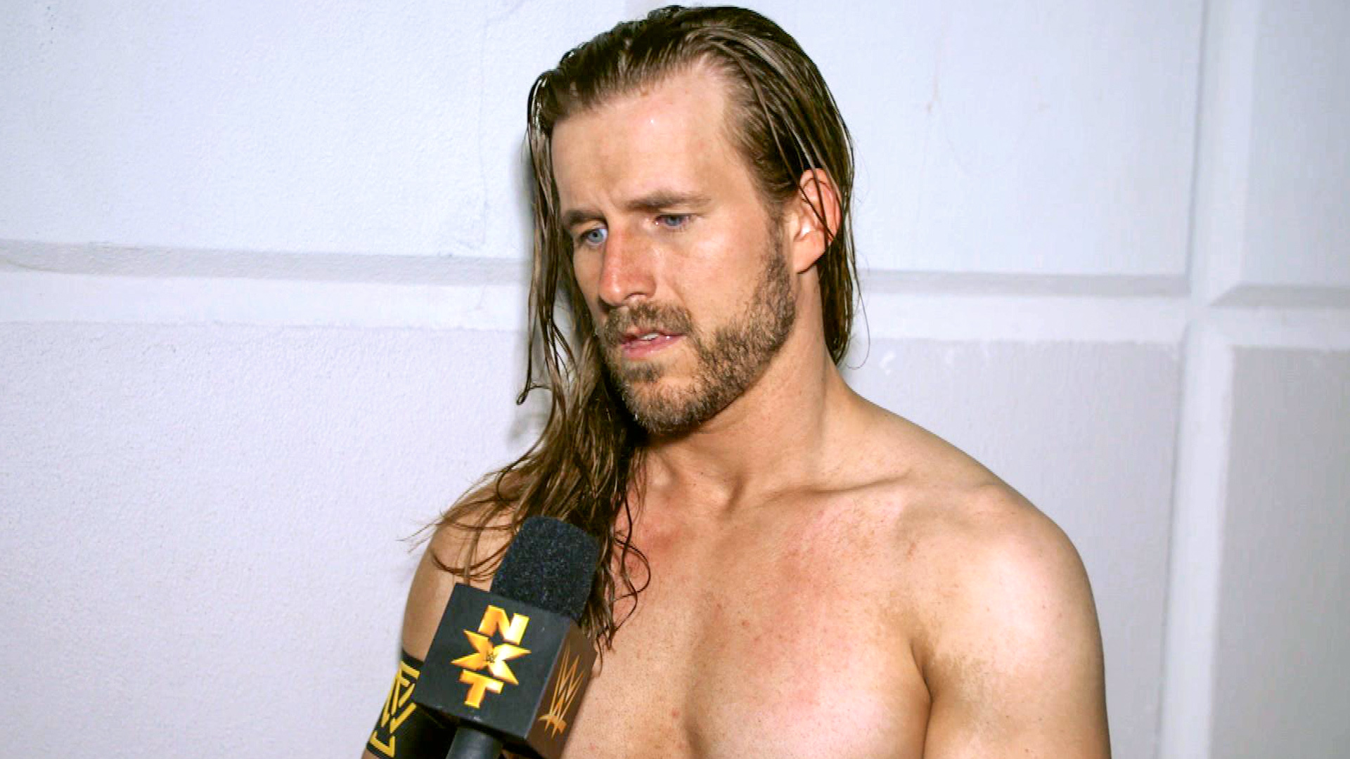 Photo of Adam Cole is 6'6″