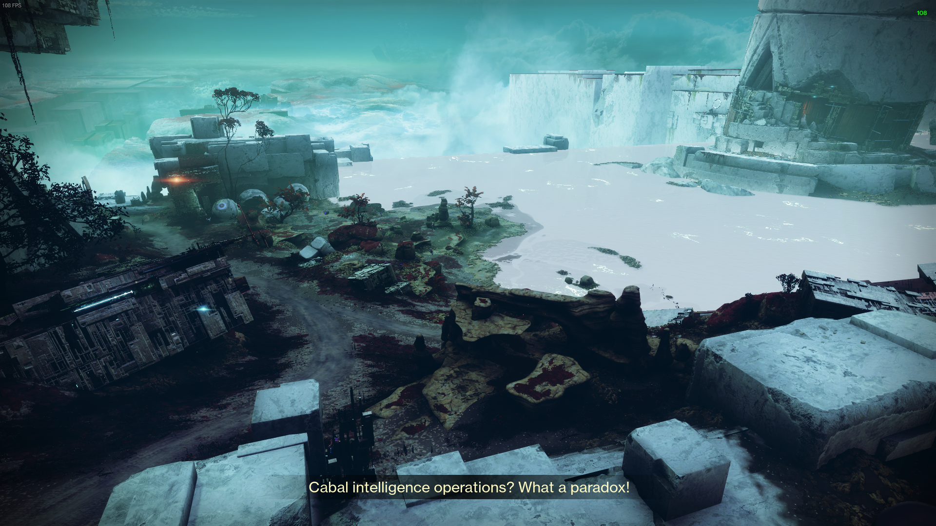 The waterfront of the Vex river viewed from above at a distance. It's mossy and green in color, almost like a marsh.
