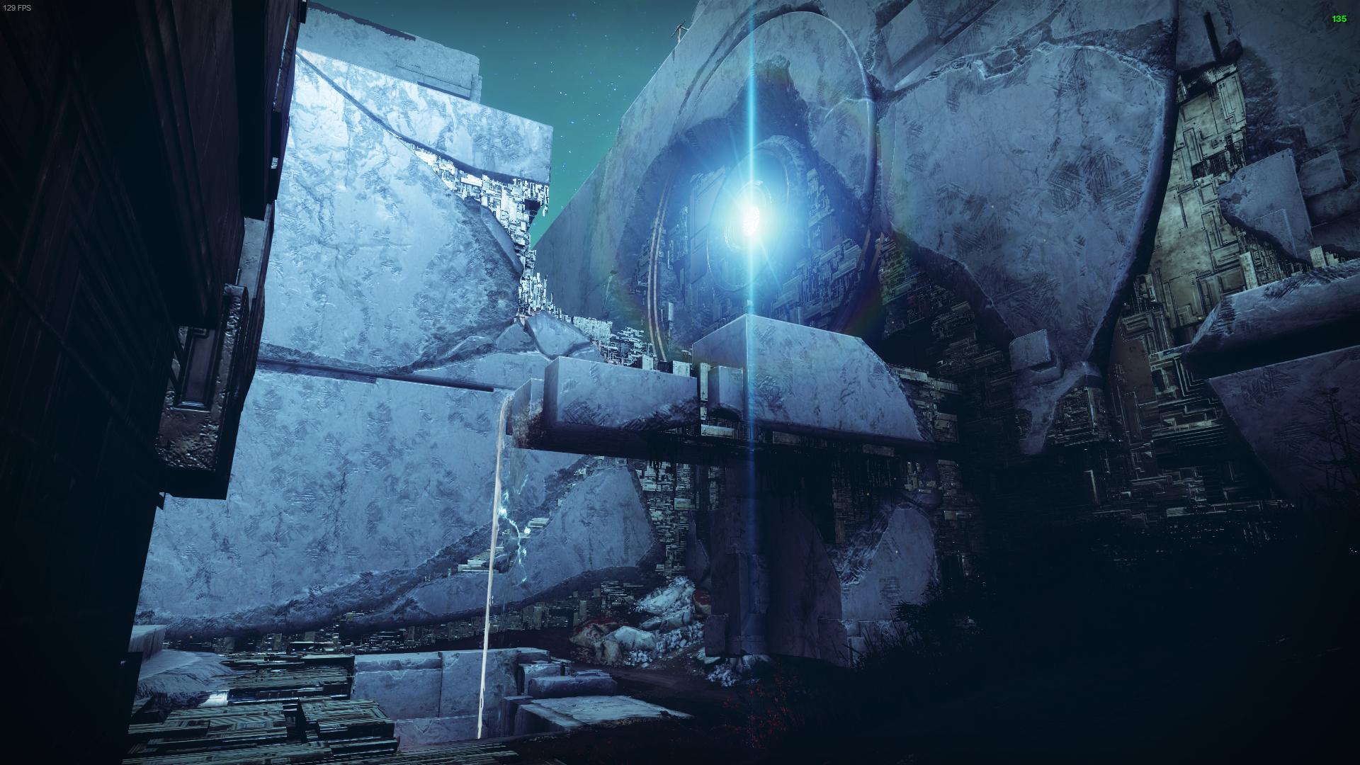 The smaller Vex waterfall near the spawn point on Nessus. A bright blue light shines from a broken circle on the wall.