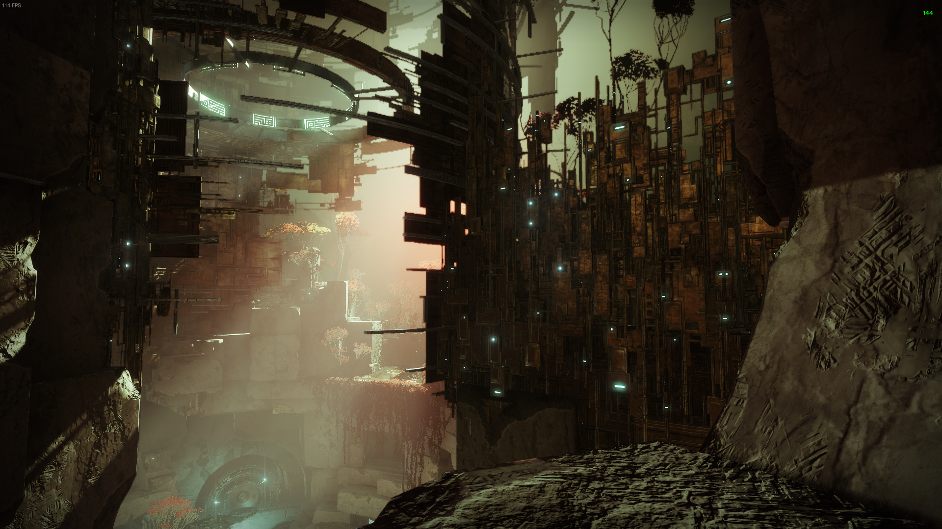 First person. A guardian overlooks a tall circular Vex structure. The outside looks worn down from time.