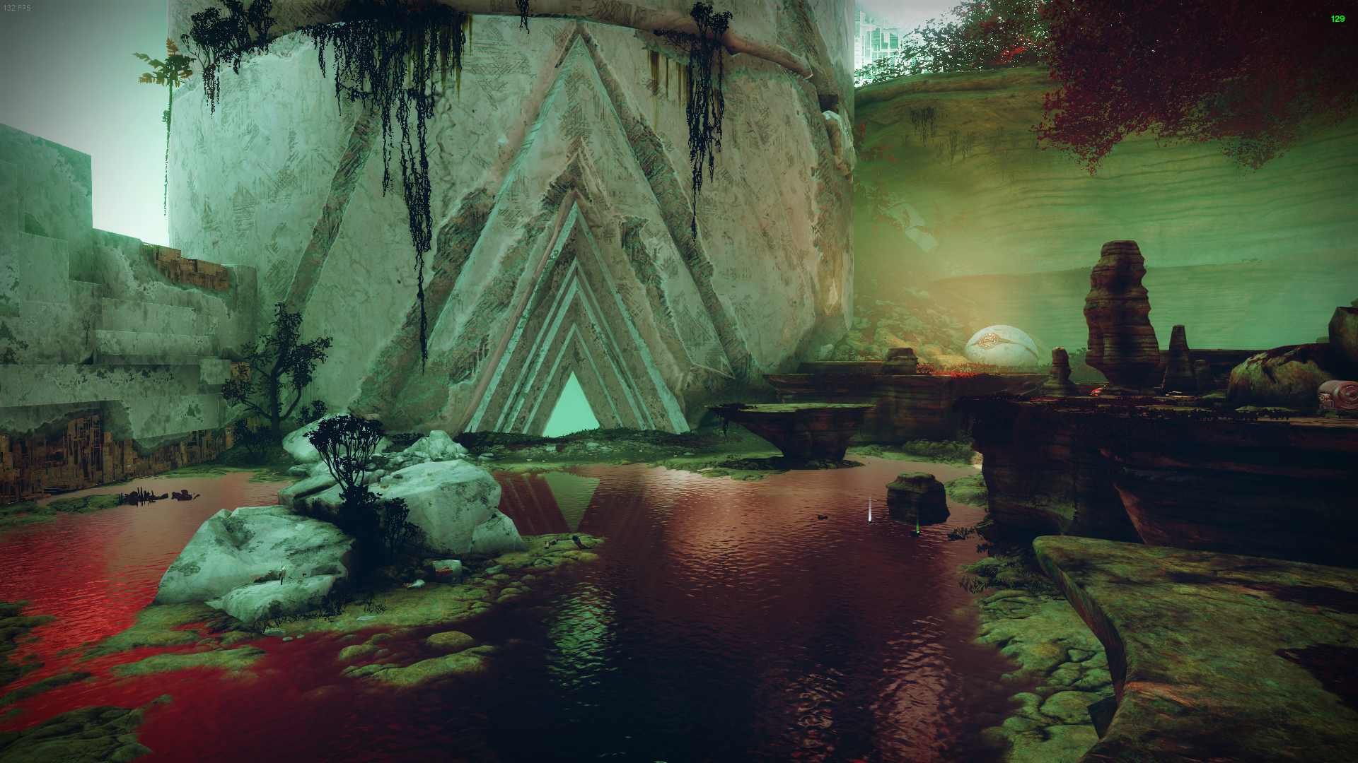 Concentric triangles mark an entrance into a Vex tower. The shapes reflect in the water of the pond just outside. Rocky outcrops decorate the area.