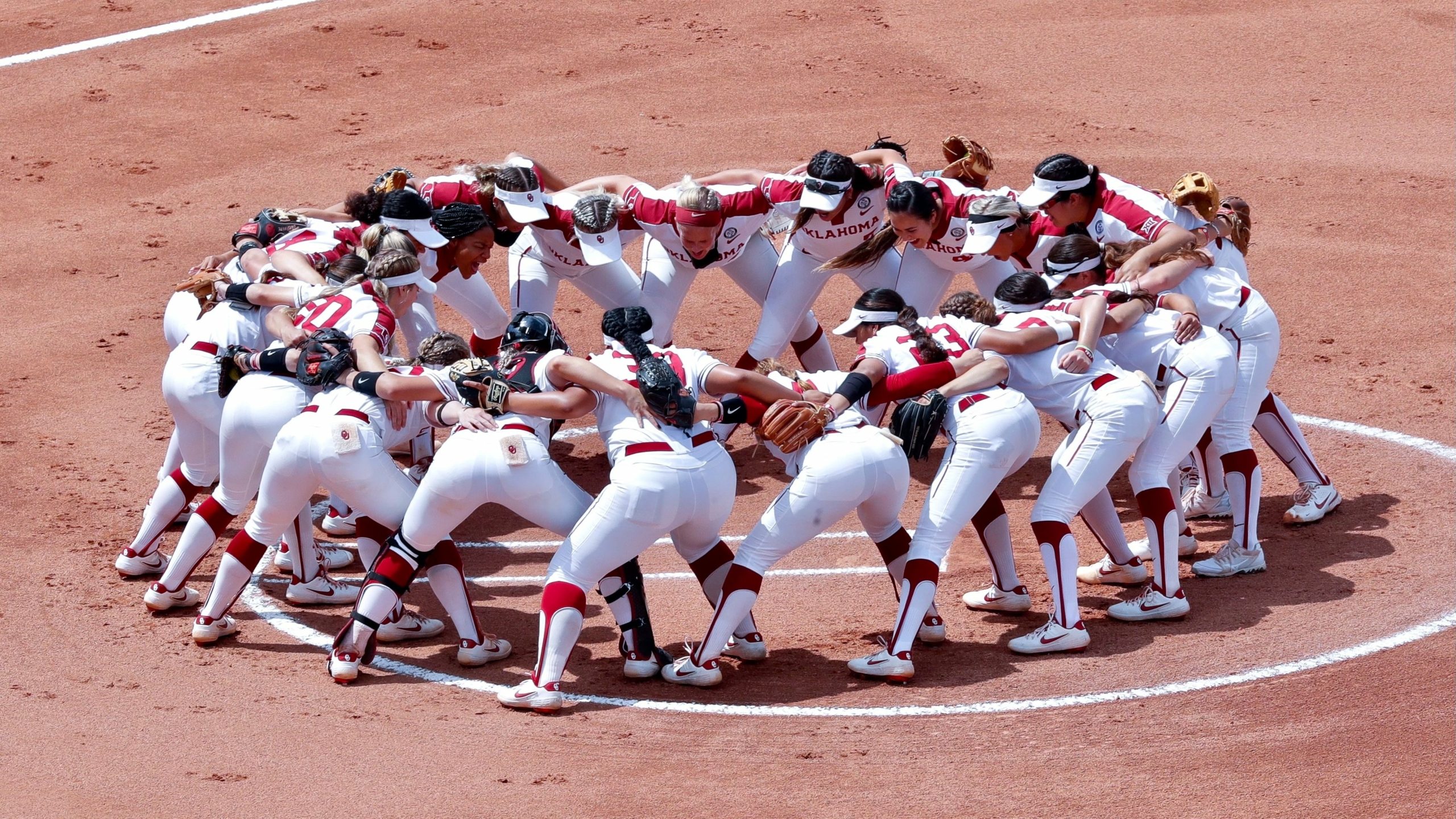Oklahoma Softball team in a huddle