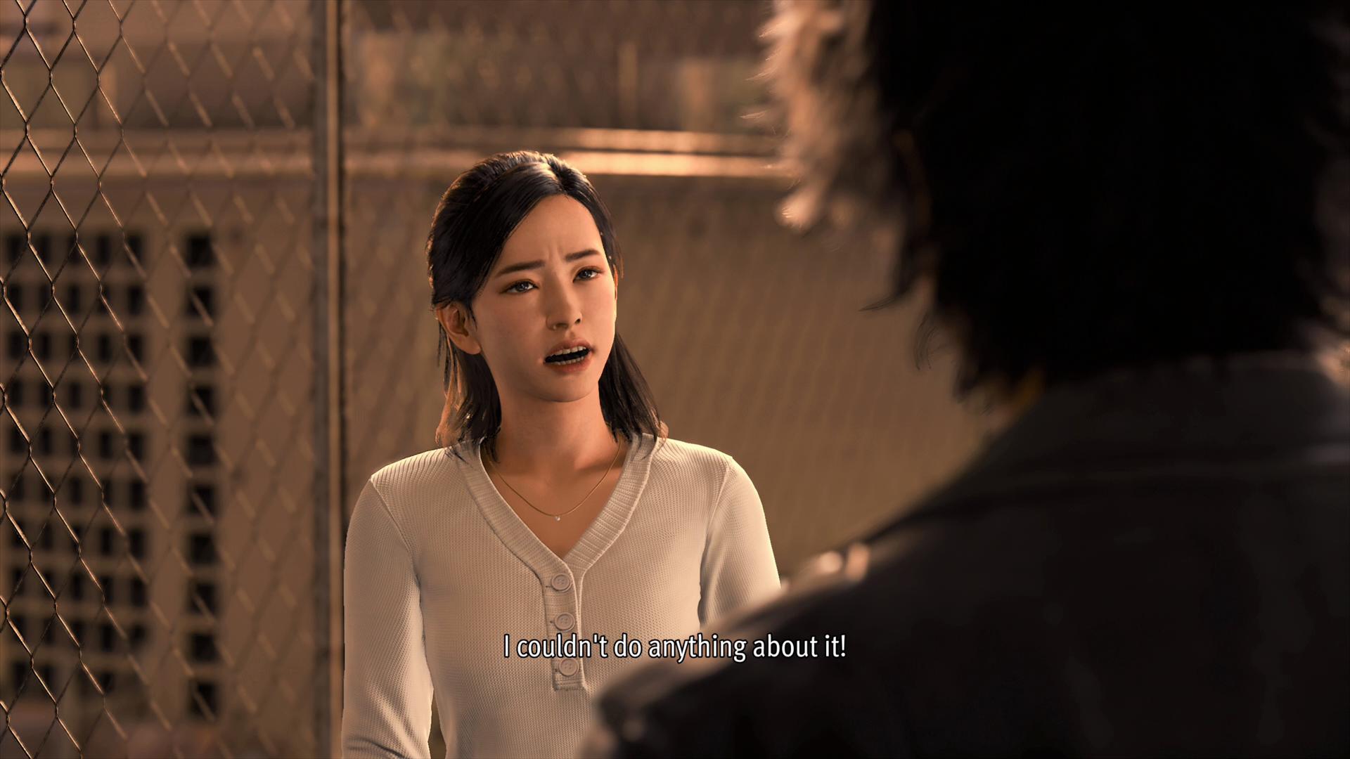 Yoko Sawa berbicara dengan Yagami di Lost Judgment